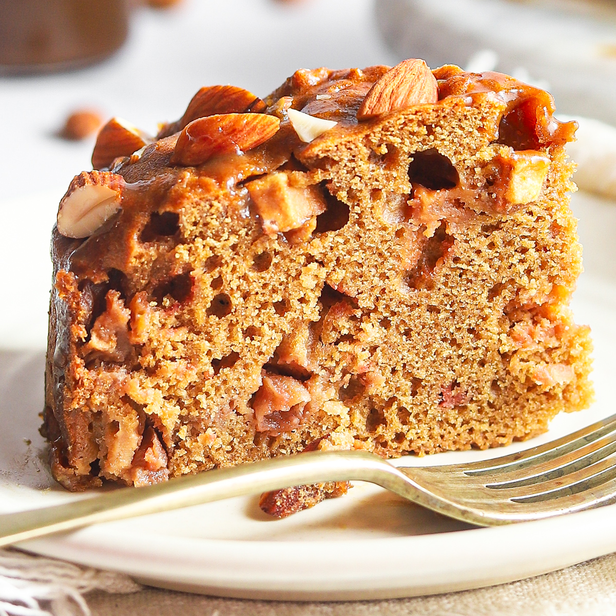Slice of toffee apple cake with apple pieces - close up