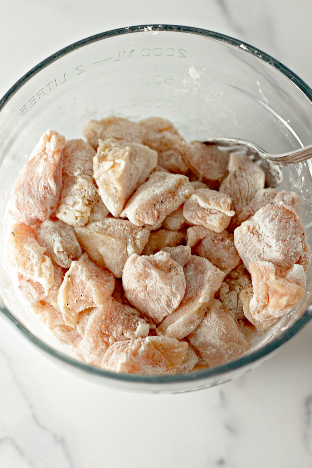 chicken breast pieces tossed with cornstarch and seasonings