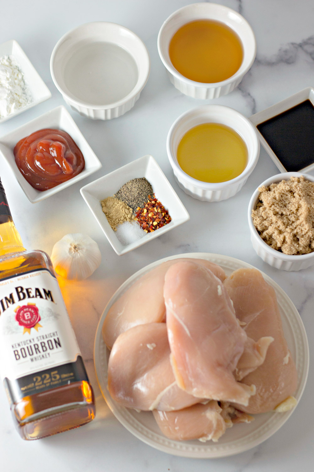 ingredients for bourbon chicken measured out in bowls