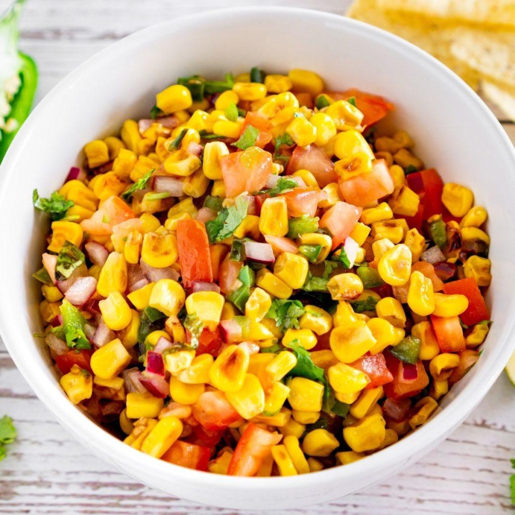 charred corn salad in a white bowl