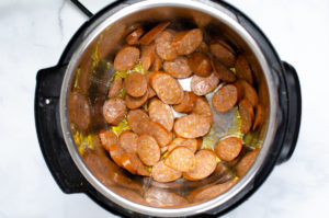 sliced Cajun sausage sauteing in an instant pot