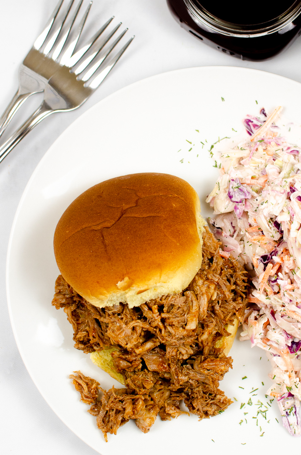 BBQ pulled pork sandwich with a side of creamy coleslaw
