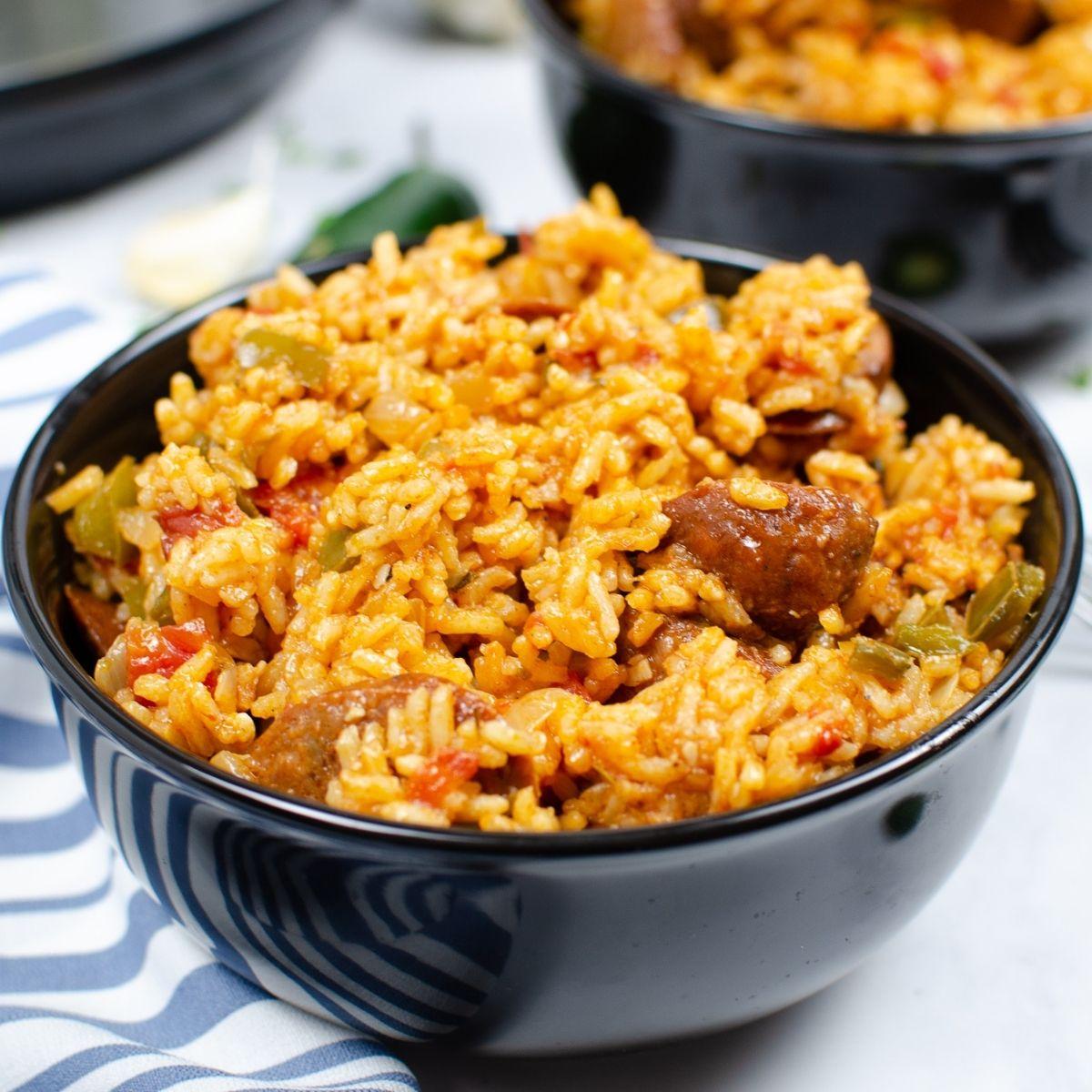 sausage jambalaya in a black bowl