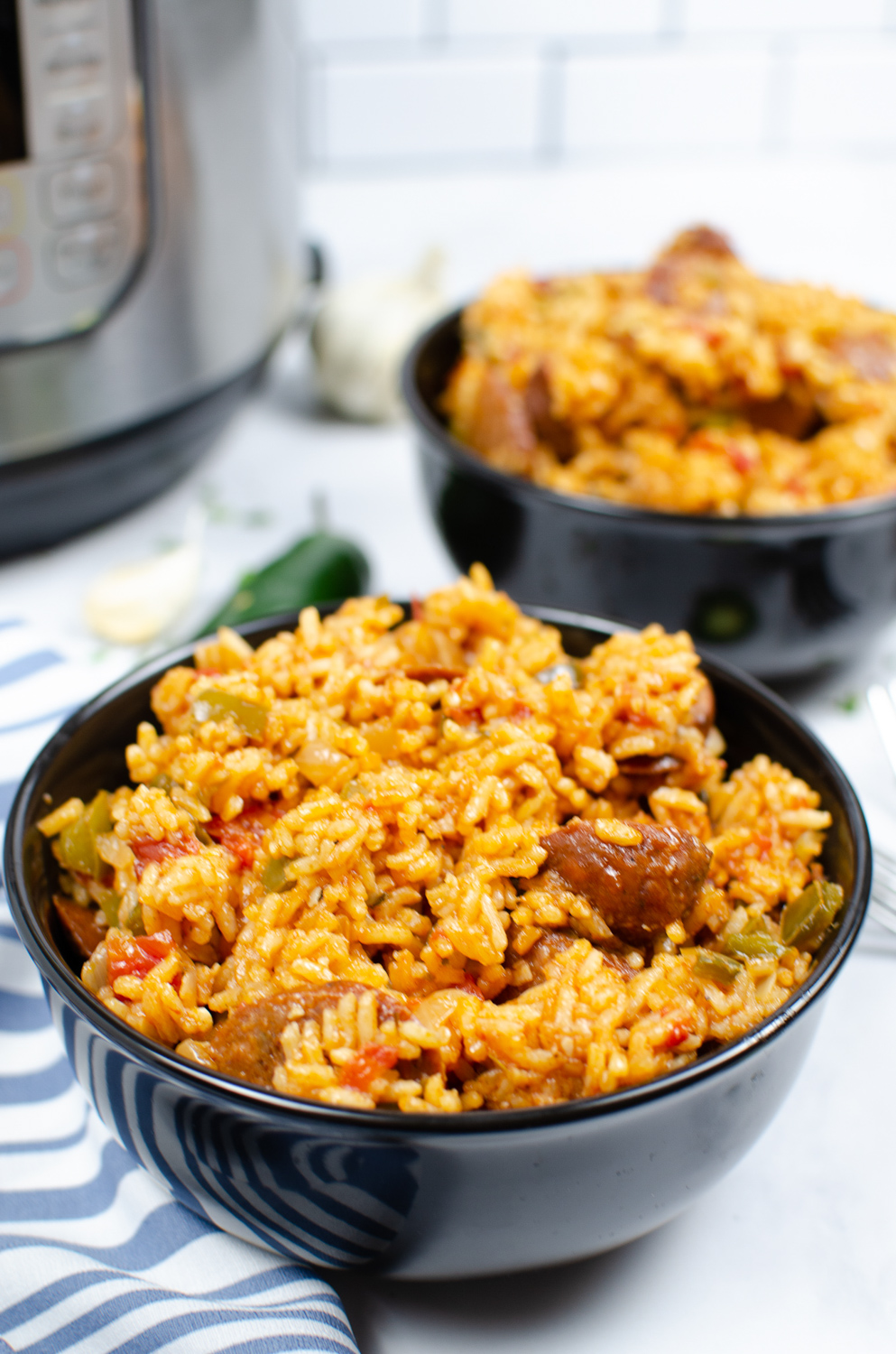 2 bowls of jambalaya in front of an Instant Pot