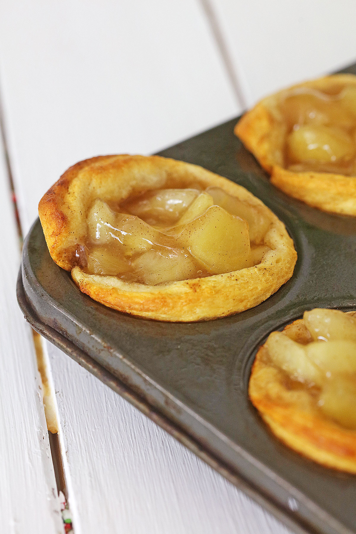 baked mini apple pies in a muffin pan