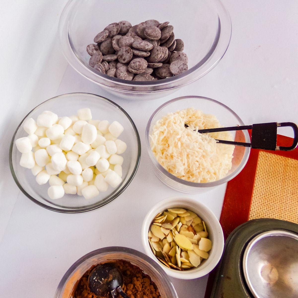 ingredients to make hot chocolate bombs with marshmallows and almonds