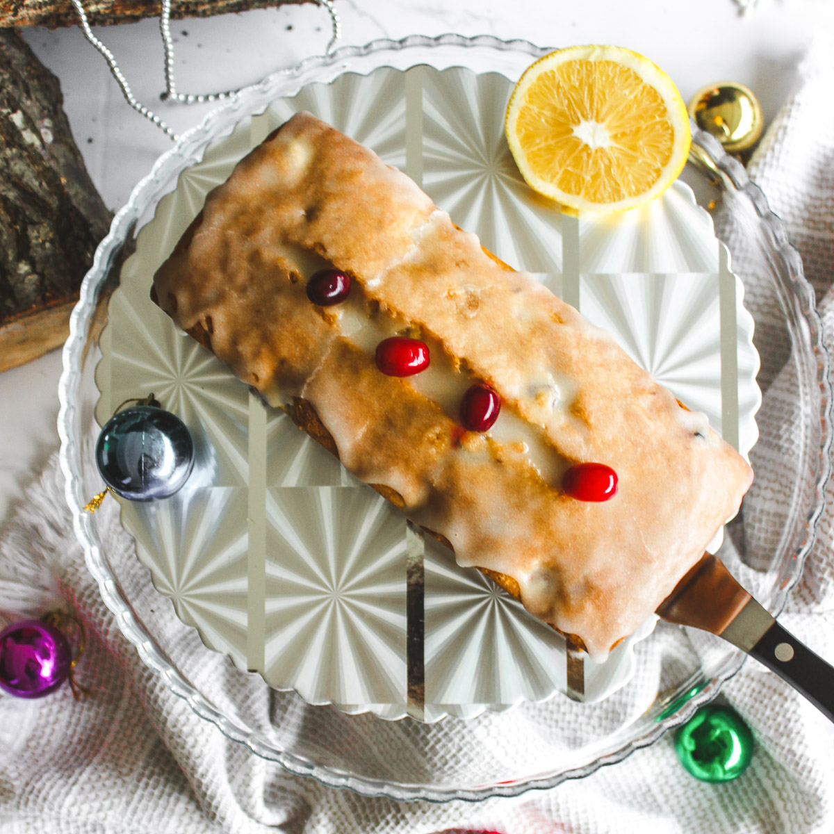 overhead shot of holiday cranberry orange pound cake decorated with cranberries