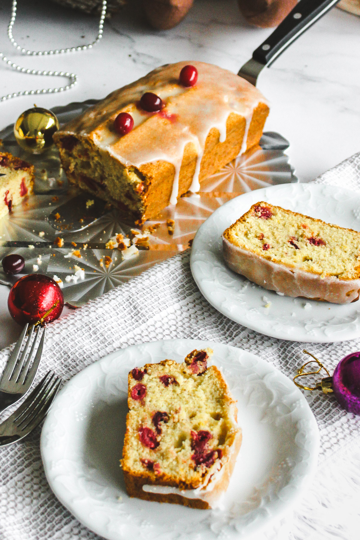 slice of holiday pound cake with cranberries with holiday decorations