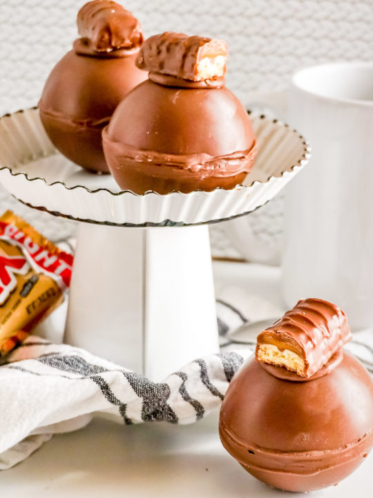 twix hot cocoa bombs on a display stand