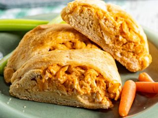 3 pieces of buffalo chicken crescent roll appetizer on a plate