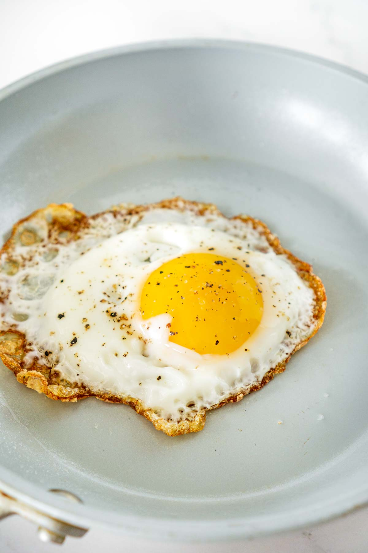 fried egg with crispy edges in a skillet