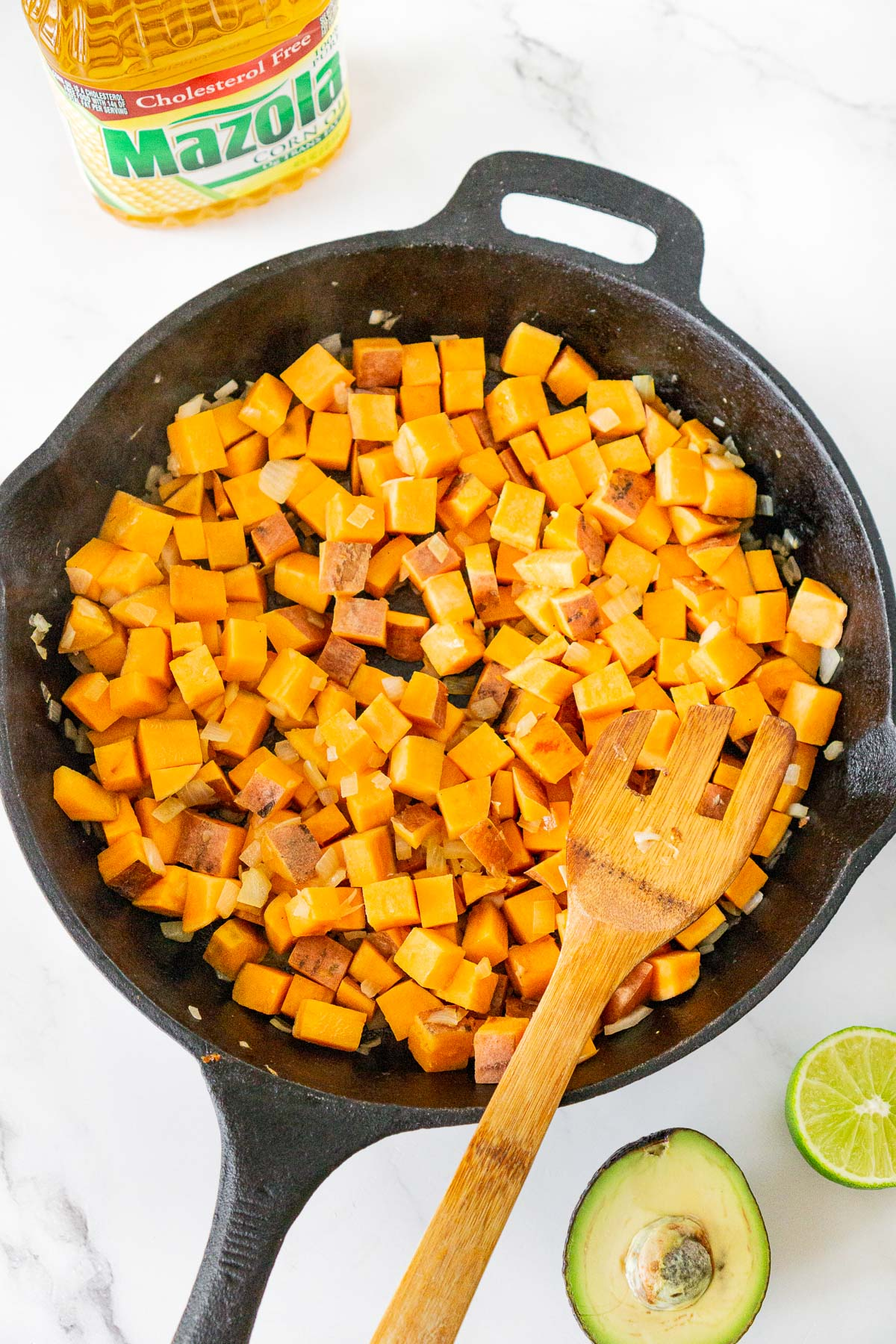 cubed sweet potato cooked in a skillet