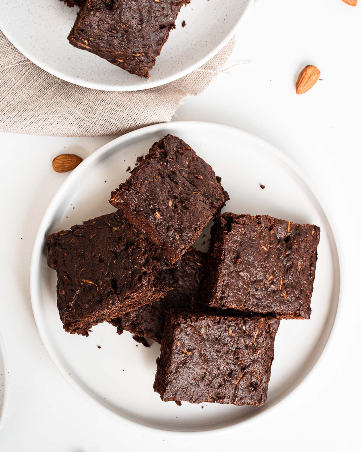 Plate of sliced brownies with zucchini.