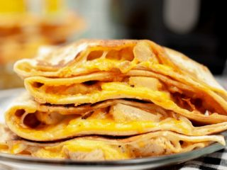 Chicken quesadilla on a plate.
