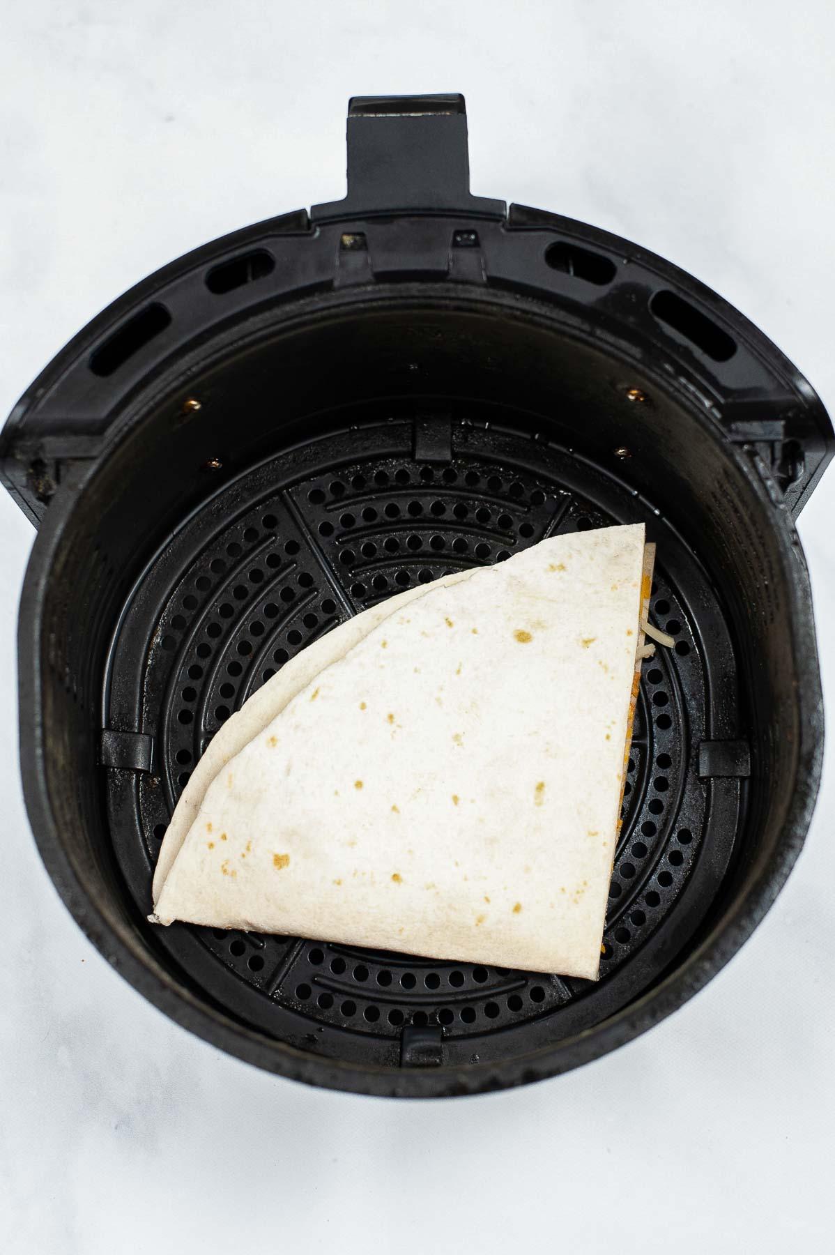 Making a quesadilla in an air fryer.