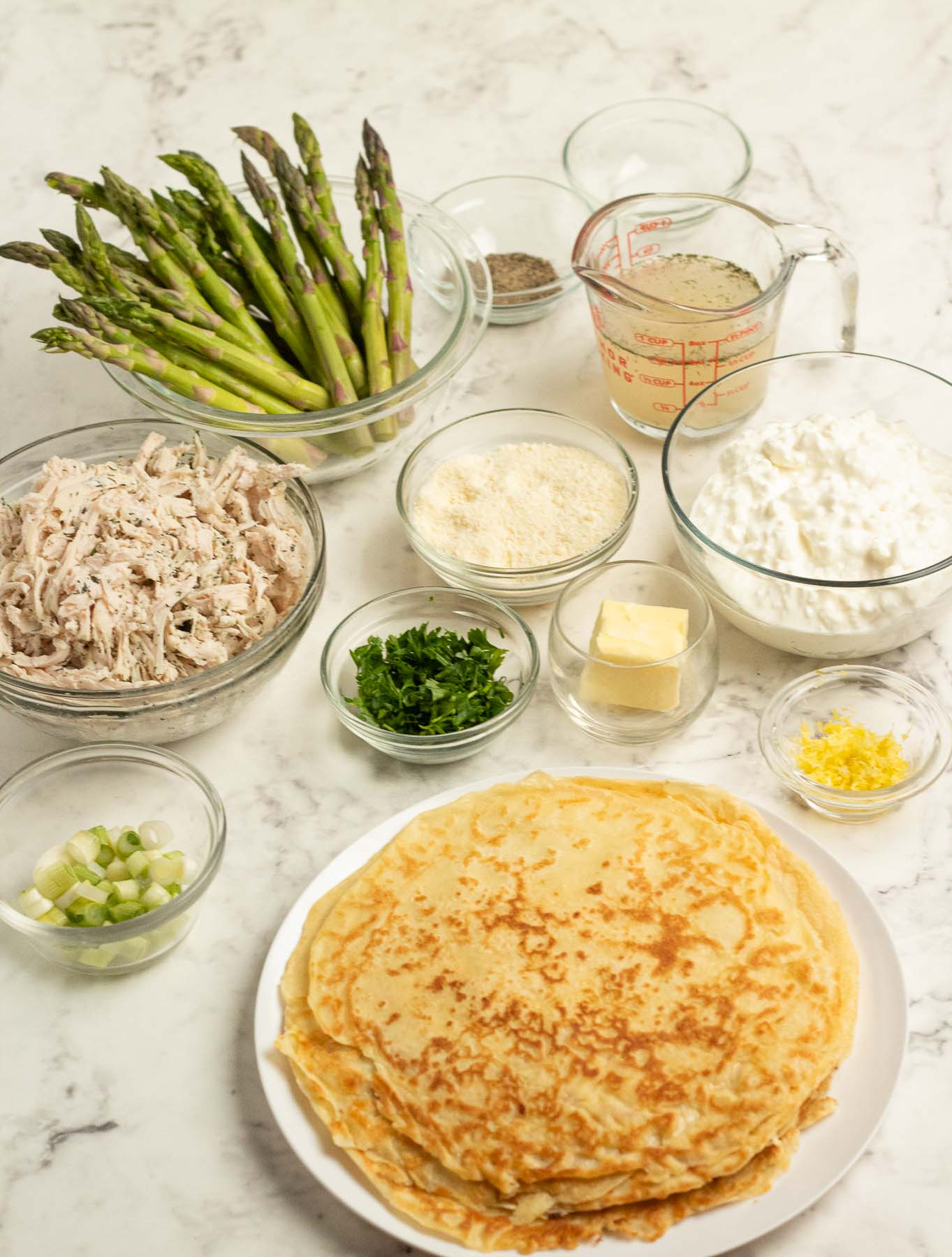 Ingredients for savory chicken crepes with asparagus.