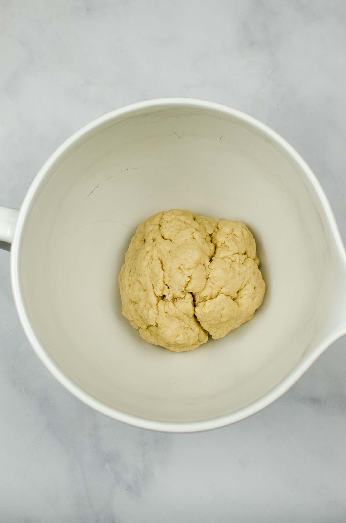 Flour tortilla dough rolled into a ball.