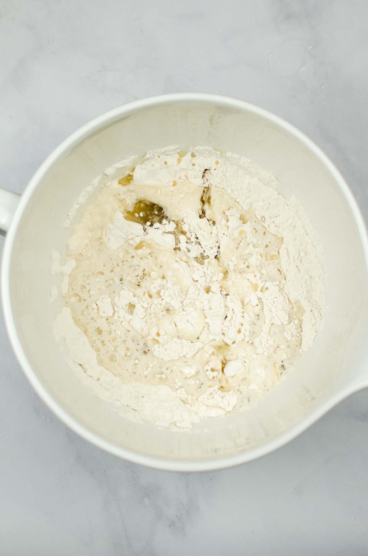 Rough tortilla dough in a bowl.