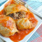 Golubtsi stuffed with ground beef and rice on a plate.
