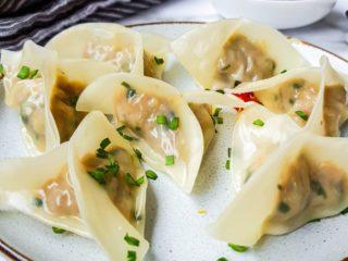 Pork dumplings on a plate.