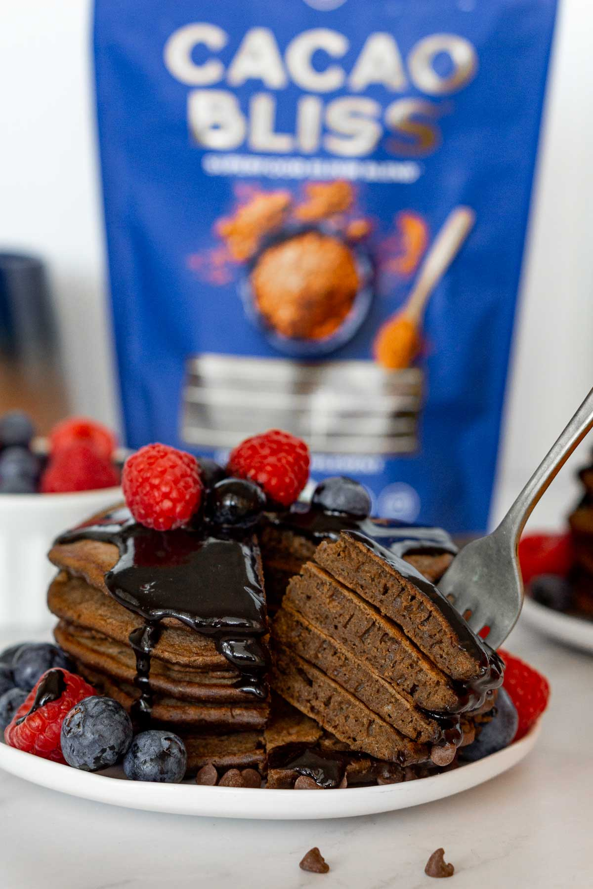 Stack of chocolate pancakes cut open.