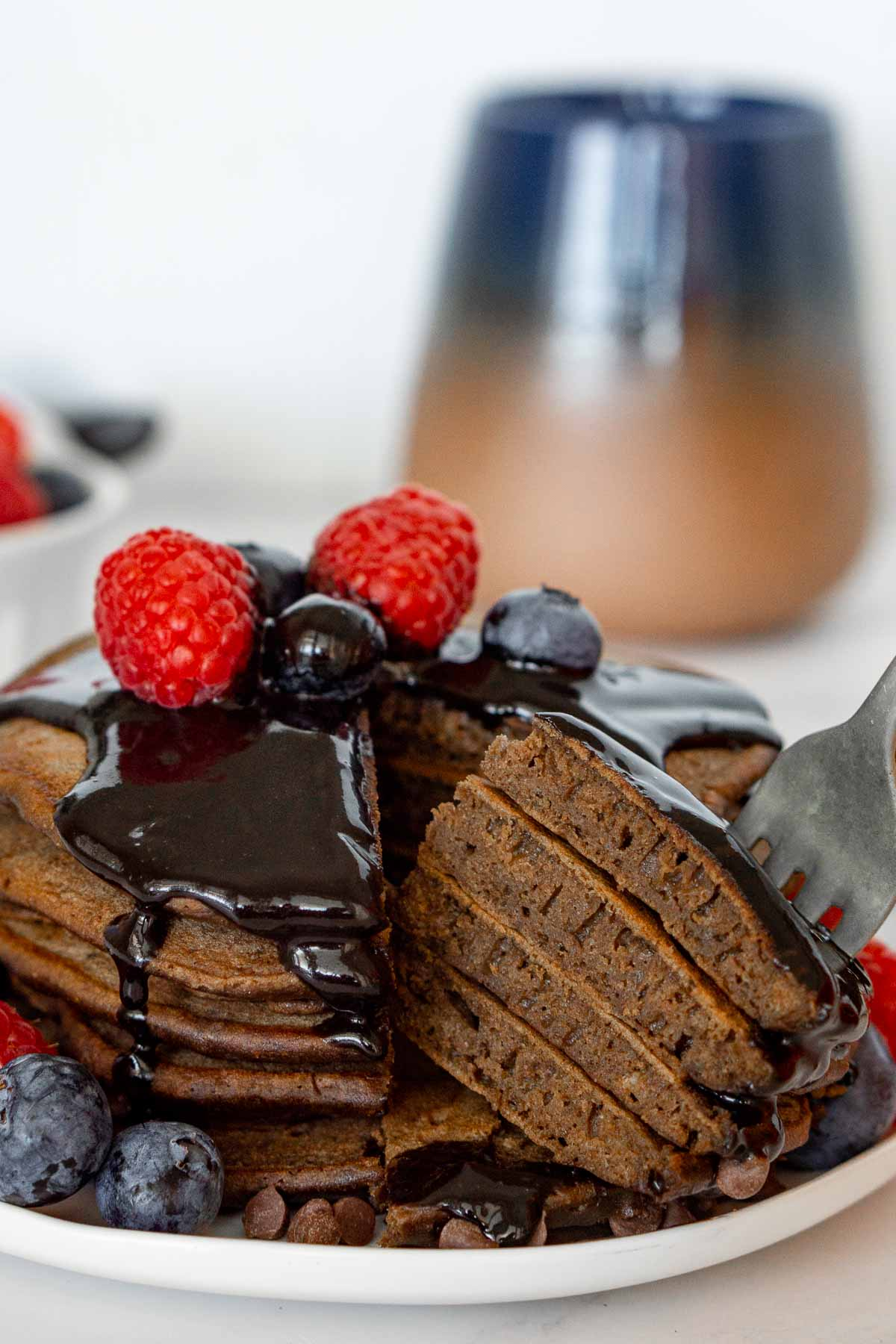 Stack of chocolate protein pancakes cut open.