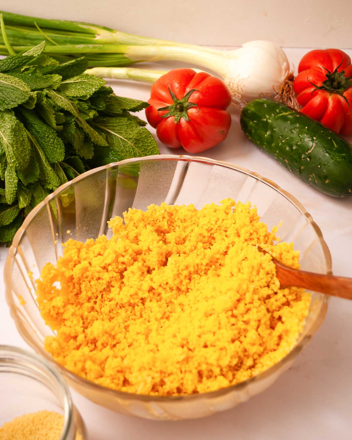 Bowl of golden couscous with turmeric.