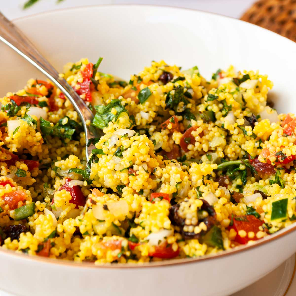 Bowl of couscous salad with cucumber and tomato