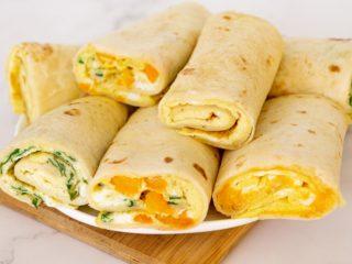 Plate of tortilla egg breakfast wraps.