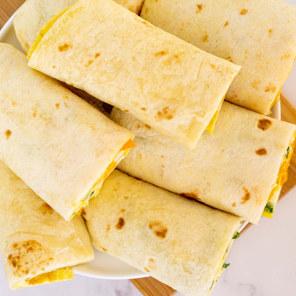 Tortilla egg wraps on a plate.