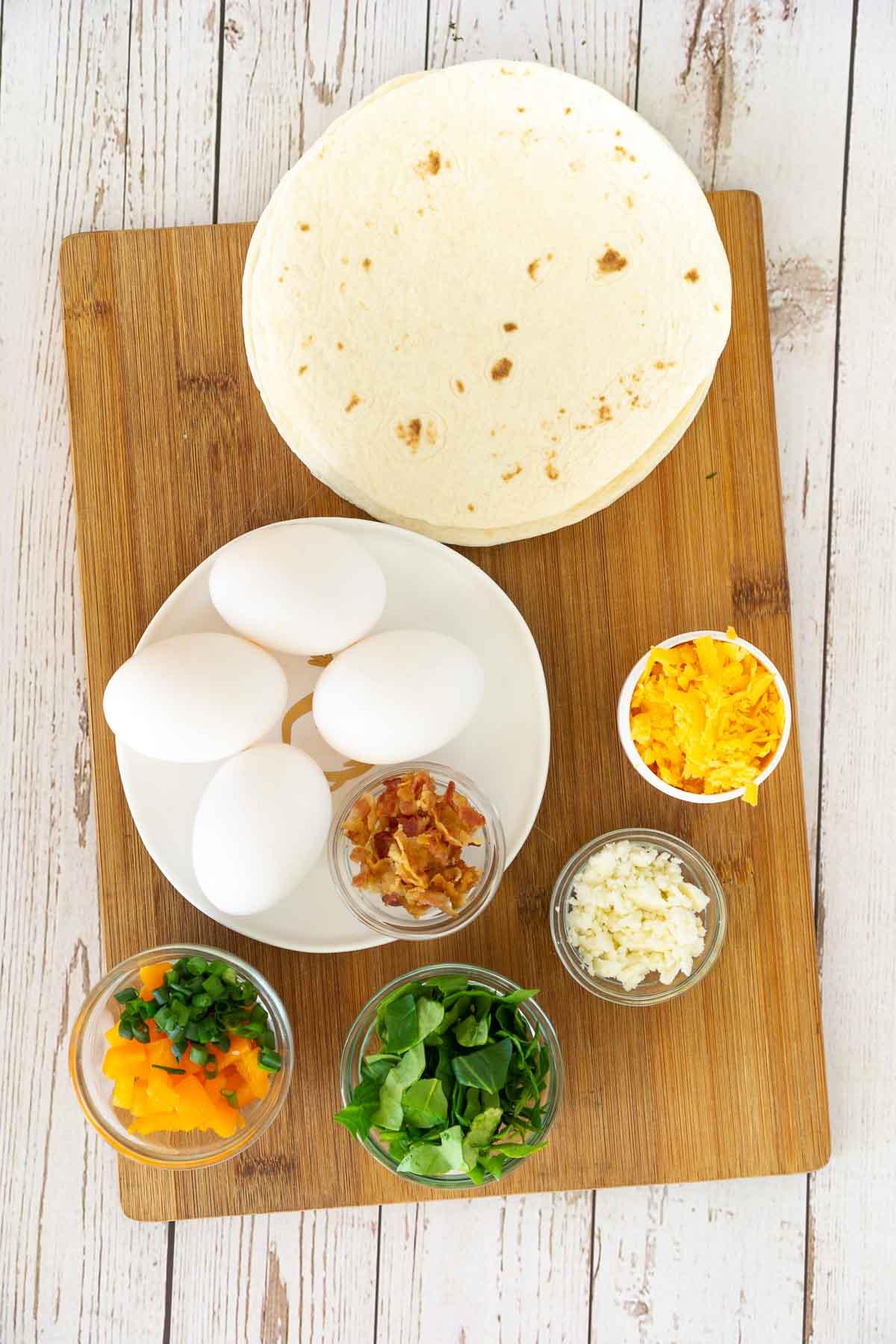Ingredients to make tortilla egg skillet wraps.