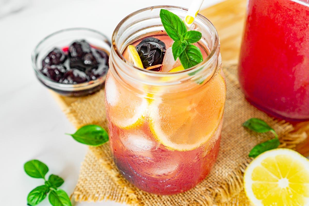 Cherry lemonade in a glass jar.