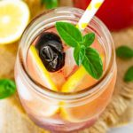 Cherry lemonade with garnish in a jar.