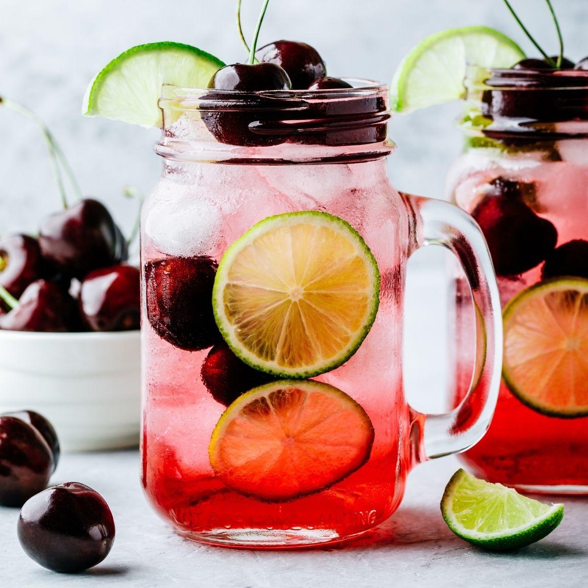 Cherry limeade in a mason jar mug.