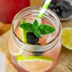 Cherry limeade with fresh lime garnish.