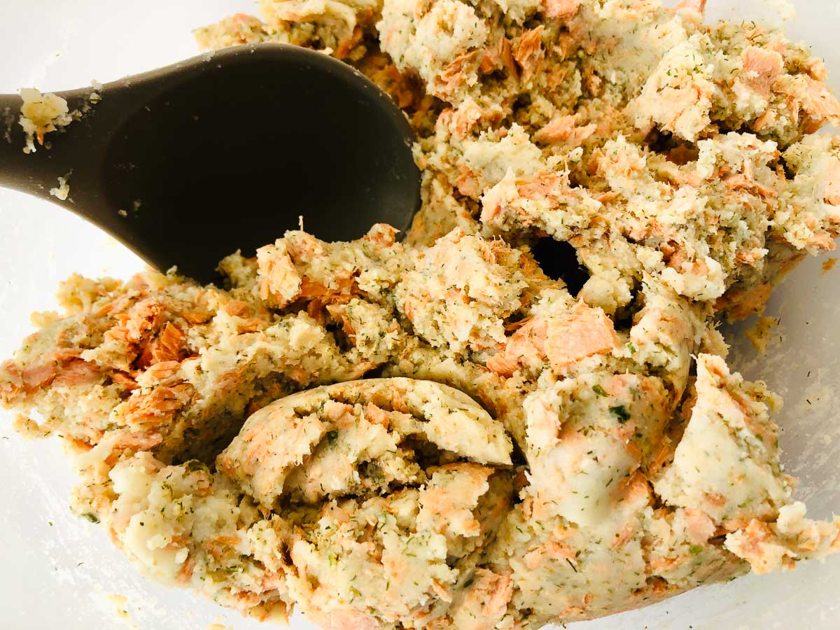 Salmon and mashed potato mixture in a bowl.
